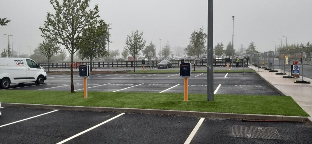 benefits of electric car charger stations in the workplace